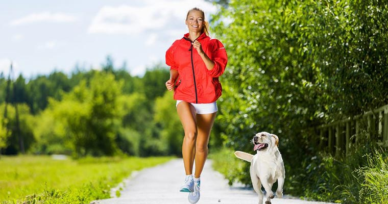 Girl doing exercise with his dog